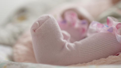 Baby girl feet in pink socks Footage