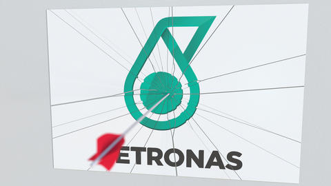 Archery arrow breaks glass plate with PETRONAS company logo. Business issue Live Action