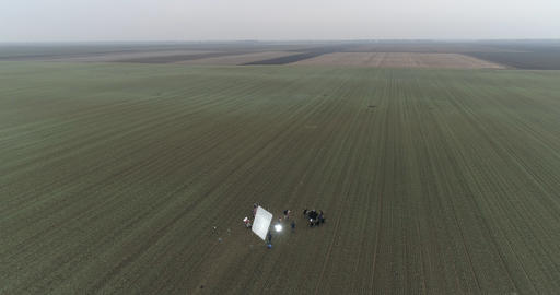 Film Crew setting up scene in crop field Winter 3 フォト