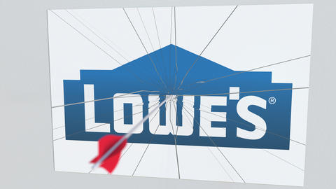 LOWES company logo being hit by archery arrow. Business crisis conceptual Footage
