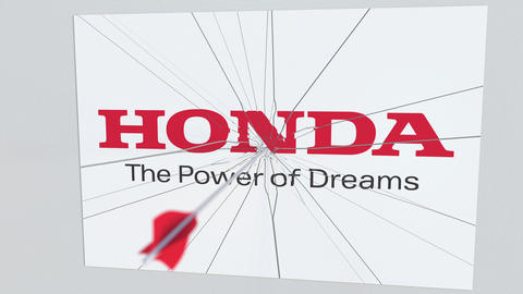 HONDA company logo being hit by archery arrow. Business crisis conceptual Footage