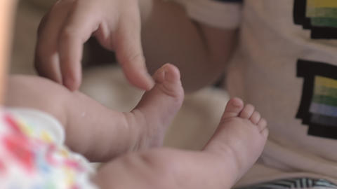 Brother with baby sister at home Footage