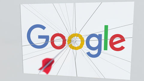 Archery arrow hits plate with GOOGLE logo. Corporate problems conceptual Live Action