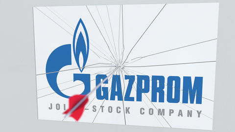 GAZPROM company logo being hit by archery arrow. Business crisis conceptual Live Action