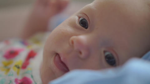 Portrait of two months baby girl at home Stock Video Footage