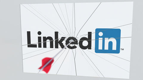 LINKEDIN company logo being cracked by archery arrow. Corporate problems Live Action