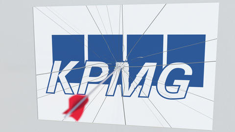 KPMG company logo being cracked by archery arrow. Corporate problems conceptual Live Action