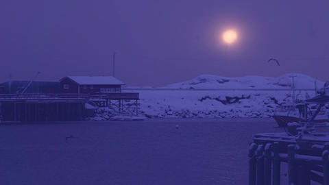 Evening Snowfall over the Winter Harbor. Slow Motion GIF