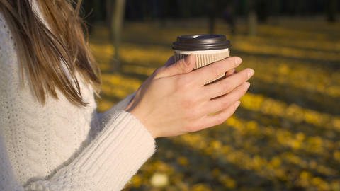 Lonely girl sipping coffee in beautiful autumn park, enjoying solitude, inspired Footage