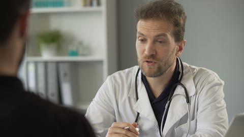 Patient giving paper with medical test results to therapist, healthcare medicine Live Action