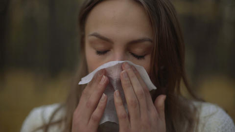 Woman suffering from runny nose, reducing immunity with onset of cold snap Live Action