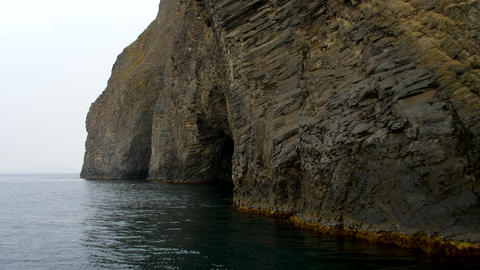 movement along the coastal cliffs of an extinct ancient underwater volcano GIF