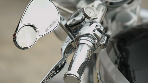 Close-up of motorcycle control panel with speedometer and handles, dashboard Live Action