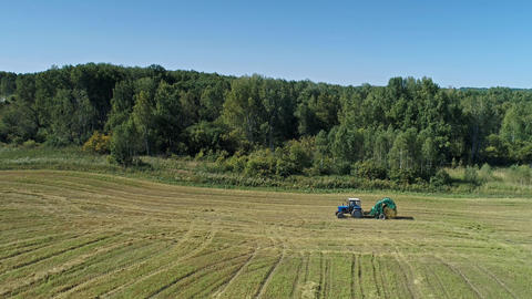 Tractor Baler Collecting Straw in the Field Footage