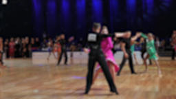 Anonymous defocused people are dancing latin dances. Ballroom dancing Live Action