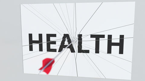 Archery arrow hits glass plate with HEALTH text. Conceptual 3D animation Live Action