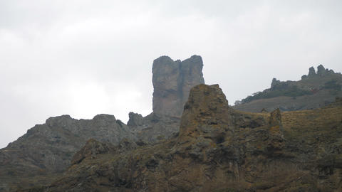 the movement along the wonderful rocks on the background of the cloudy sky Live Action
