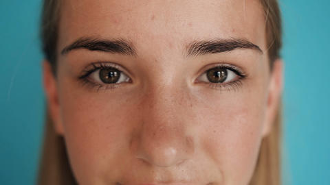 Beauty macro close-up girl's eyes blinking. Close-up of young woman's eyes, girl Footage