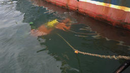 Top view from ship to underwater diver, performing diving repair work at ship Footage