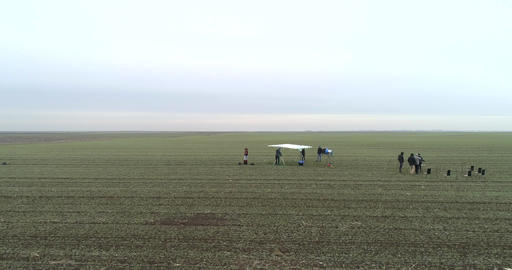 Film Crew Setting Up Scene on a field winter 4k at 50fps GIF