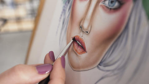 Close-up view of an artist's hand using special brush for drawing lips with Live Action