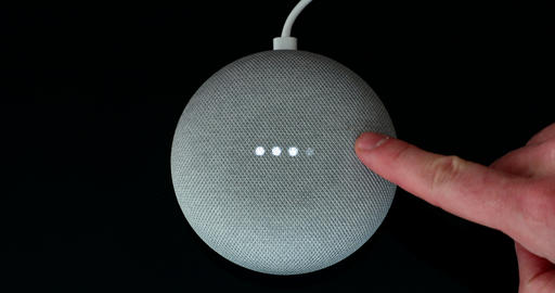 Man Adjusting Google Home Mini Volume With His Finger Footage
