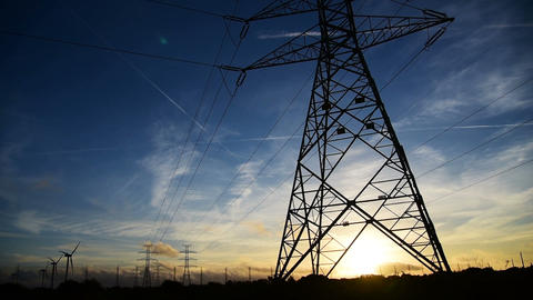 Electricity pylon in the countryside at sunset Archivo