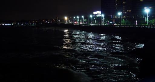 4k video,Night Ocean waves,traffic & urban building at night Footage