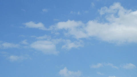 floating white clouds against the blue sky Footage