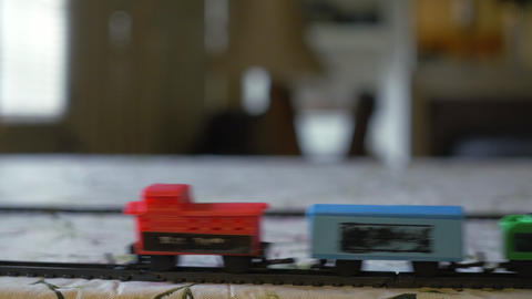 looping toy train moving around its track 4k Footage