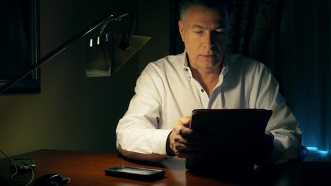 businessman working at his desk using a tablet pc Footage