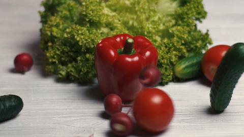 Vegetables on white table Footage
