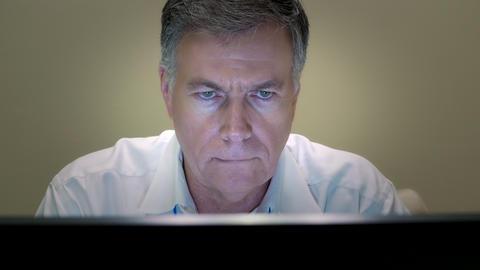 closeup businessman working at his desk smiles at camera 4k Footage