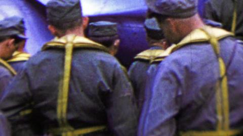 1951: US army men boarding transport plane Korean War era Footage