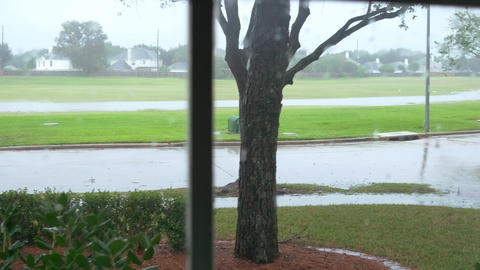 walk to window showing storm outside Footage