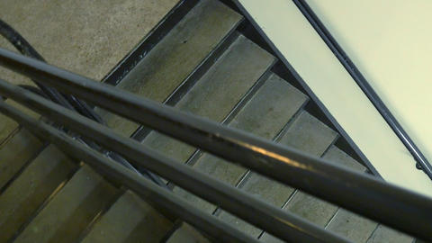walking down the emergency stairs in an office building Live Action