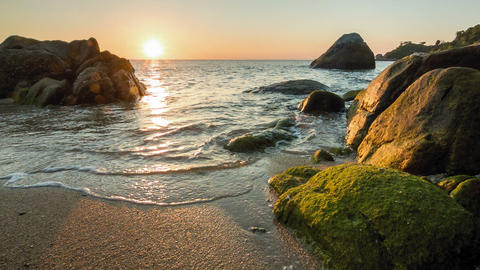 Sea sunset on the rocky shore Footage