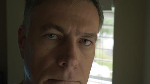 pan to closeup of middle age man looking at camera 4k Footage