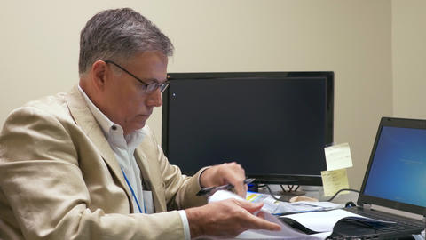 businessman making notes in some documents 4k Footage