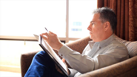 man writing notes 1 Footage