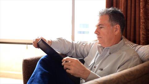 man finishing writing notes Footage