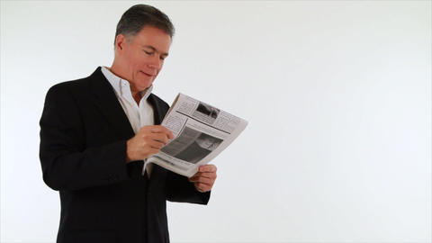 businessman reading good news in newspaper Footage