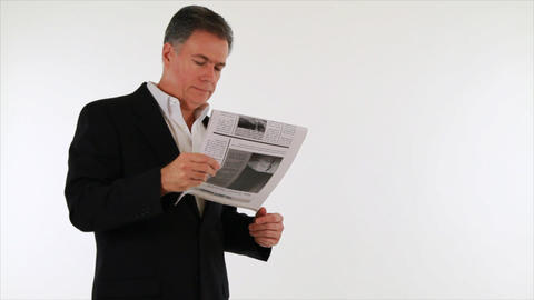 businessman reading bad news in newspaper Live Action
