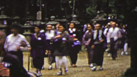 1951: Japanese senior citizens walking sacred temple grounds Footage
