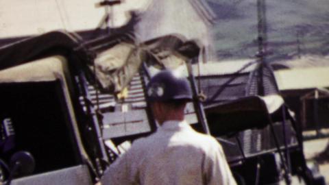 1951: US army man entering jeep transport vehicle during Korean War Footage