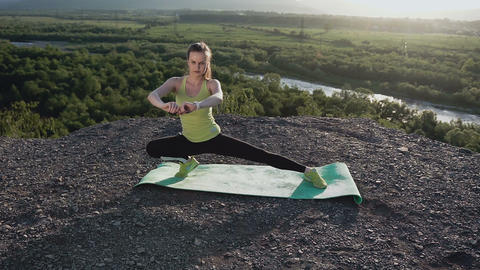 Sport woman doing stretching training. Fitness woman stretching legs before Footage