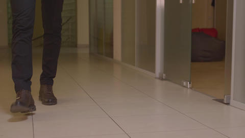 Walking on concrete : close-up view of mans brown leather shoes GIF