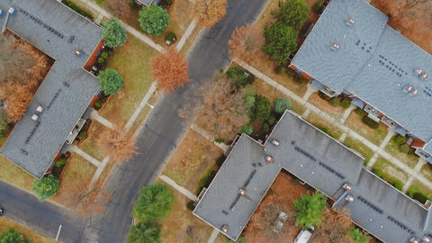 Aerial shot looking down on urban housing development - housing estate of yellow Footage