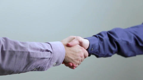 Two Corporate Business People Shake Hands Footage