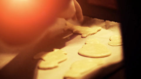 Preparing a pan to bake fresh baked christmas cookie Live Action